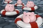 Sparschweine in Rettungsringen